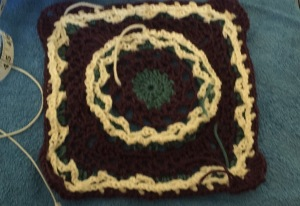 The first afghan square (still needs to be blocked and ends weaved in)